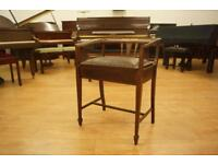 Antique piano stool/chair. Re upholstered