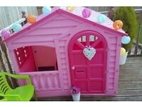 pink playhouse with table and chairs