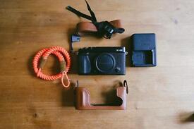 Fujifilm x-e2 body. Plus fujifilm leather half case, and extras. £299