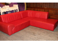 Quality hardly used modern L shaped red leather sofa