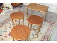 Side table coffee table on castors with 3 small folding tables which slide underneath