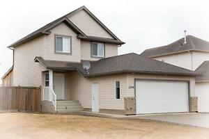 Perfect Family Home with Double Car Garage and Fenced Yard!