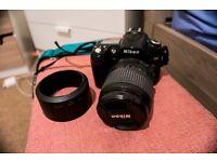 Nikon D90 + kit lens + camera bag + seat belt camera strap