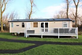Three bedroom, 8 berth, Swift serenity caravan with decking and patio area