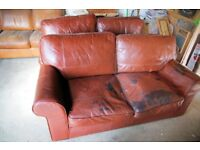 Two matching Tan Leather Sofas - with some wear/distressing
