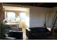 Outstanding top floor flat in Cornish Place. 1 bedroom with large mezzanine. Available 16th May.