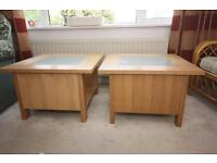 A pair of tables, pine effect veneered with frosted glass centres.