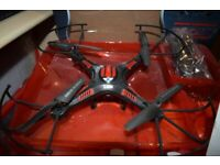 X-cam quadcopter drone with removal camera