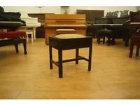 Antique black piano stool