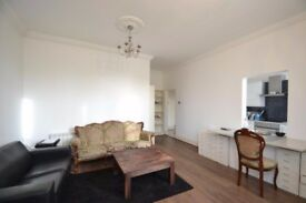 Superb 1 bed flat with high ceilings and off street parking moments from Ealing Broadway