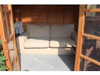 Cream 3 seated sofa