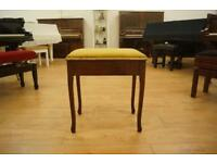 Piano stool with storage. Mahogany and upholstered