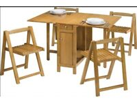 Foldaway dining table and chairs - brand new