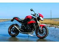 Triumph Speed Triple 2011 in red (not GSXR R1 CBR) needs gone
