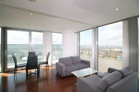 AMAZING 33RD FLOOR 2 BEDROOM APARTMENT STUNNING RIVER VIEWS LANDMARK TOWER CANARY WHARF E14 BALCONY