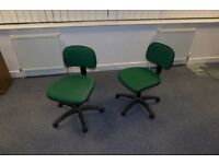 2x green spinny desk chairs