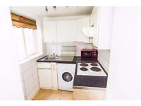 Spacious studio flat in this period conversion property in Gloucester Terrace, Lancaster Gate, W2