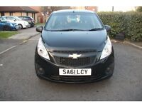 nice black colour chevrolet spark 1.0 manual petrol very low expenses to have a good looking car low