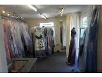 Established dress business for sale with building