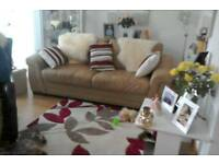 a. Three seater leather sofa in great condition