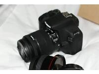 Canon 100r mint condition with 18-55 is lens never used