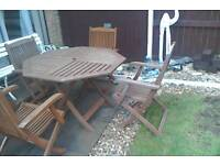 Wooden garden table and 4 arm chairs