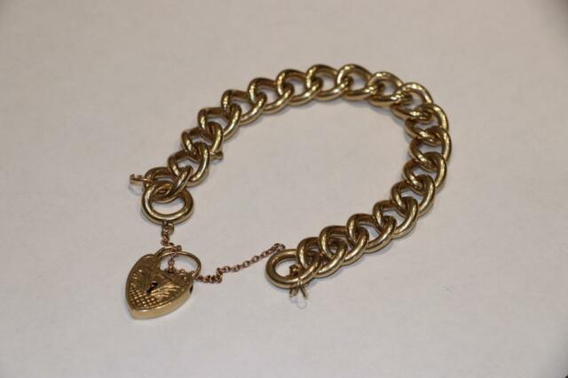 c8af2bc2b45b9 BARGAIN Heavy 64.1g Solid 9ct Gold curb charm bracelet with heart padlock  (not 14ct,18ct,22ct,24ct) | in Bermondsey, London | Gumtree