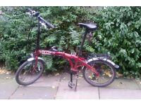Red folding bike - Carrera to sell!