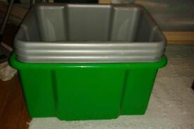 Four plastic stackable storage boxes/toy crates in good clean condition
