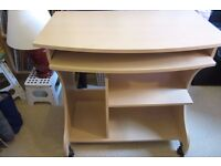Computer table - very good condition - brakes on 2 front casters - extending shelf