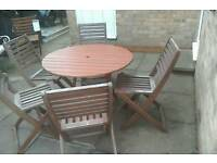 Wooden garden table and 5 chair's