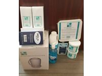 Waxing kit: heater; pre/post waxing lotion, wax, etc.