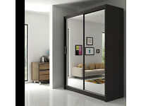 A German 2 Door Sliding Mirror Wardrob with Extra Shelves, 2 Hanging Rails- Brand New