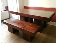 Wooden dining table with benches