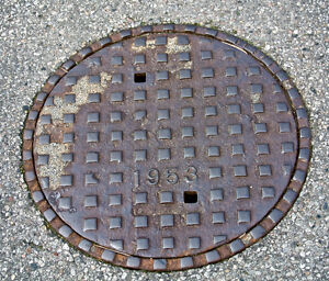 Road construction:catch basin lid,man hole cover,asphalt,