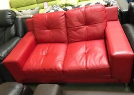 Red leather DFS 2 seater sofa