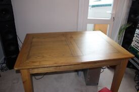 Solid oak extendable dining table with 6 leather chairs