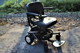 TRAVELUX QUEST FOLDING ELECTRIC WHEELCHAIR
