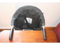 Mothercare portable child's seat which clips securely onto a table. Used a little