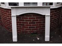 Wooden white painted fire surround