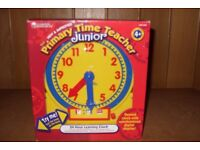 24 hour learning clock, age 4 and up, new still in box.