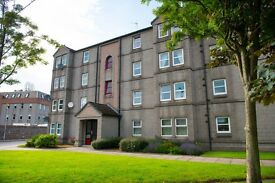 Recently decorated two bed fully furnished apartment with private parking