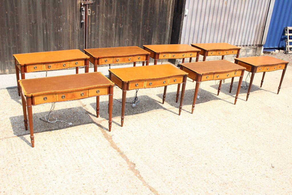 Joblot of 8 Reproduction Serpentine Writing Table Console Tables with power socketsin Upminster, LondonGumtree - Joblot of 8 Reproduction Serpentine Writing Table Console Tables with power sockets. These beautiful English handmade writing tables in serpentine design are made from solid mahogany and with burr maple inlay around the drawers and top edge of the...
