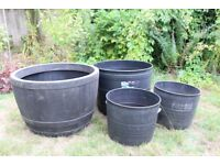 FOUR STEWART PLASTIC PLANTING TUBS IN GOOD CONDITION