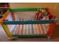 multi colour baby travel cot with foldable mattress. Optional IKEA mattress