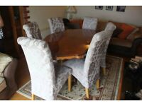 Antique style dining table with 6 rich fabric chairs.