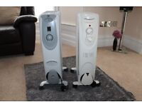 2 oiled filled free standing electric heaters