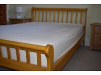 Pine sleigh double bed