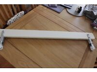 White wooden toddler bed guard