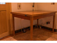 wooden table with side panel extenders.
